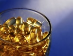 Spoonful of fish oil capsules
